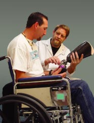 Photo of  young man being fitted with an artificial limb by an Prosthetist-Orthotist